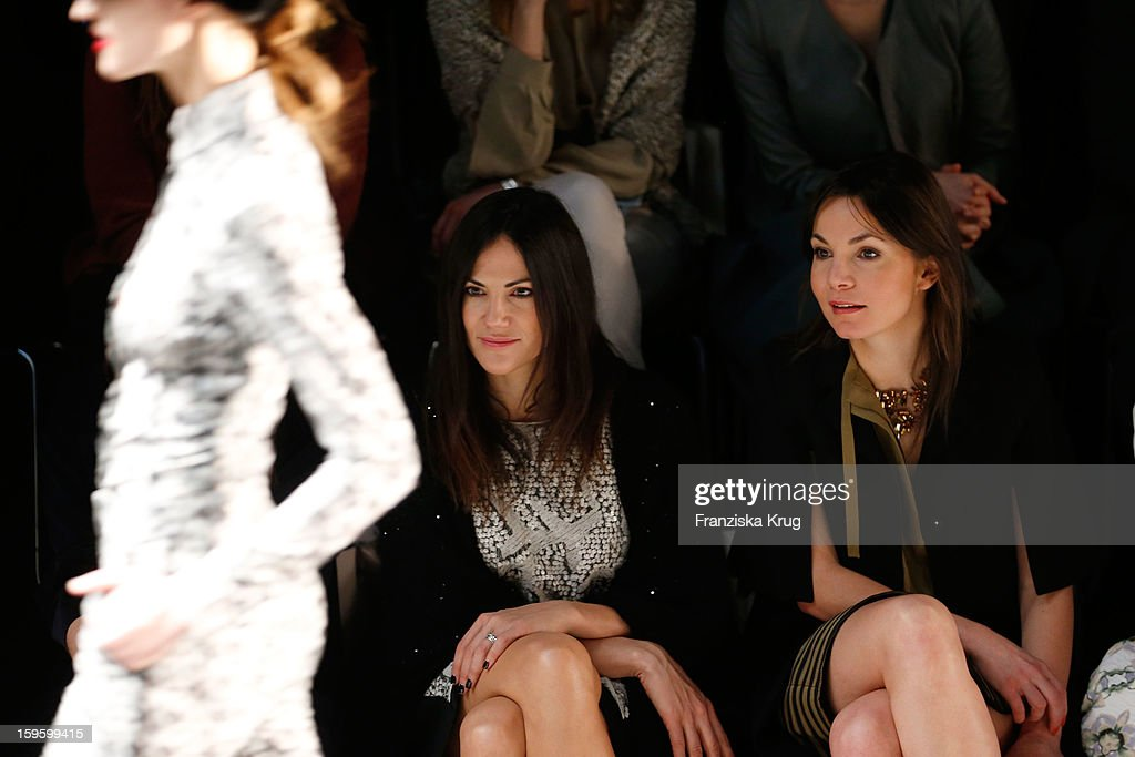Nadine Warmuth and Bettina Zimmermann attend Schumacher Autumn/Winter 2013/14 Fashion Show during Mercedes-Benz Fashion Week Berlin at Brandenburg Gate on January 17, 2013 in Berlin, Germany. on January 17, 2013 in Berlin, Germany.
