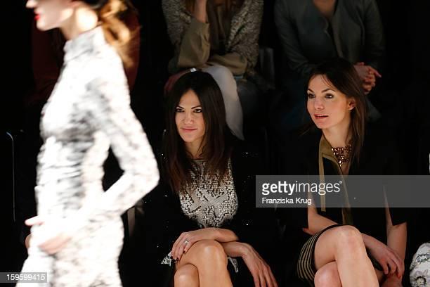 Nadine Warmuth and Bettina Zimmermann attend Schumacher Autumn/Winter 2013/14 Fashion Show during MercedesBenz Fashion Week Berlin at Brandenburg...