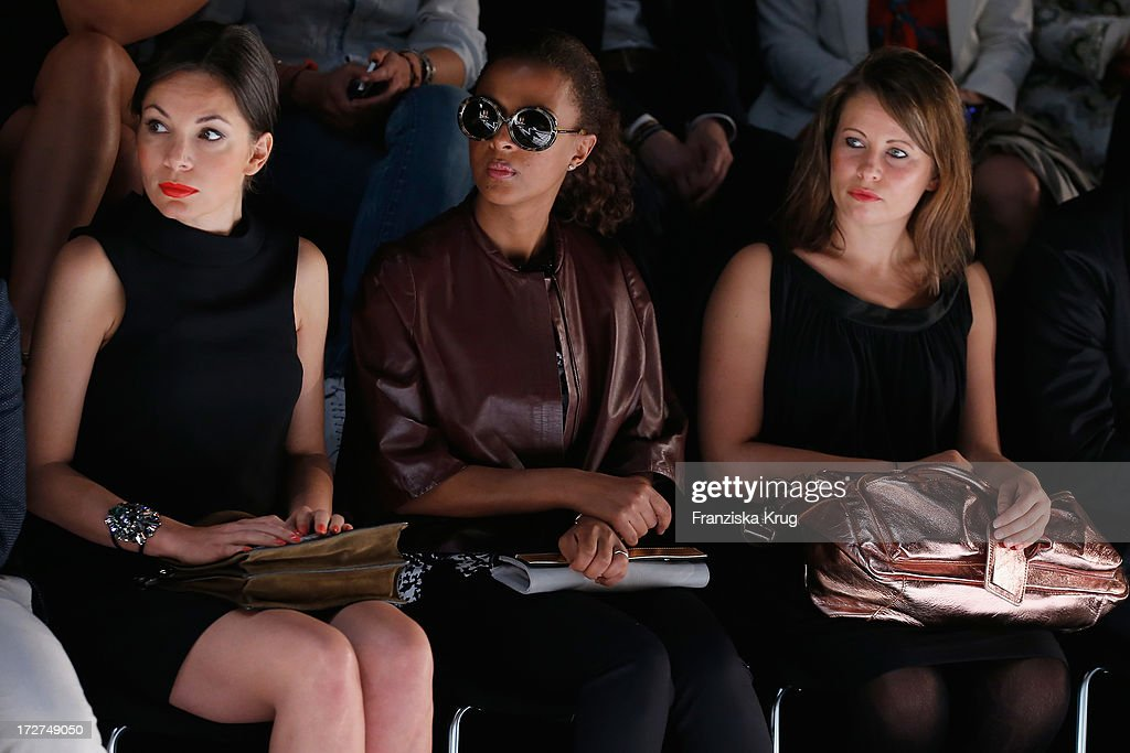 <a gi-track='captionPersonalityLinkClicked' href=/galleries/search?phrase=Nadine+Warmuth&family=editorial&specificpeople=628371 ng-click='$event.stopPropagation()'>Nadine Warmuth</a> and Dennenesch Zoude attend the Schumacher Show during Mercedes-Benz Fashion Week Spring/Summer 2014 at Brandenburg Gate on July 4, 2013 in Berlin, Germany.