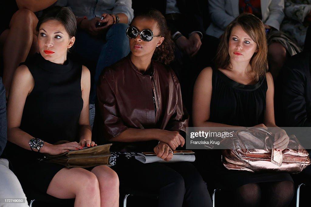 Nadine Warmuth and Dennenesch Zoude attend the Schumacher Show during Mercedes-Benz Fashion Week Spring/Summer 2014 at Brandenburg Gate on July 4, 2013 in Berlin, Germany.