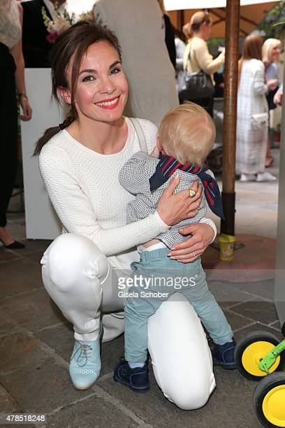 Nadine Warmuth and her son attend the Triumph Filmfest Cocktail at Cortiina Bar on June 25 2015 in Munich Germany