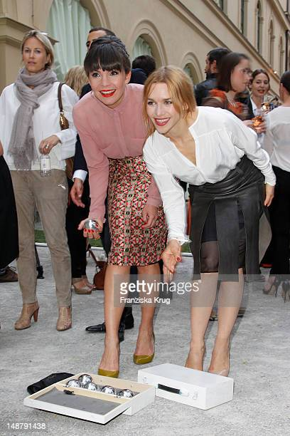 Nadine Warmuth and Julia Dietze attend the Schumacher Store Opening on July 19 2012 in Munich Germany