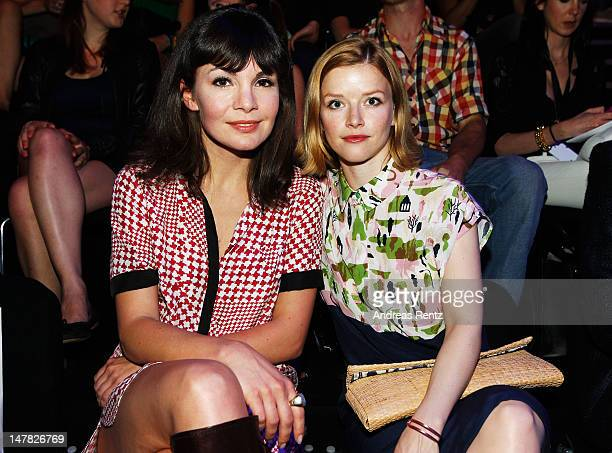 Nadine Warmuth and Karoline Schuch sit in front row during the Designer For Tomorrow show at the MercedesBenz Fashion Week Spring/Summer 2013 on July...