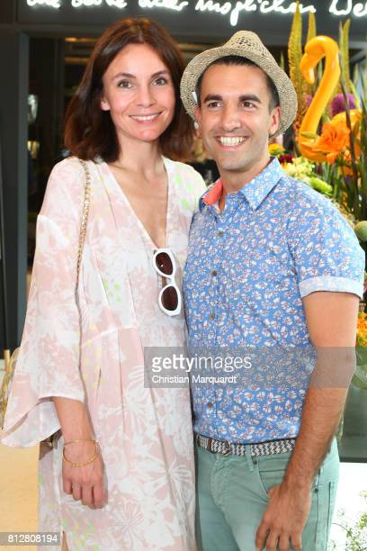 Nadine Warmuth and Kian ShamsDolatabadi attend the 'Kians Garden Flower Shop' Opening Event at Kantstrasse on July 11 2017 in Berlin Germany