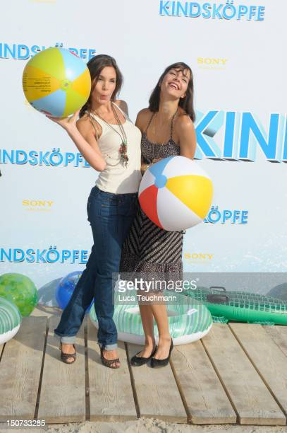 Nadine Warmuth and Susan Hoecke attend the Beach BBQ for the German Premiere of 'Kindskoepfe' at O2 World on July 30 2010 in Berlin Germany