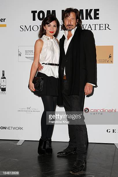 Nadine Warmuth and Tom Lemke attend the opening night of 'Smoke@thewater' by Tom Lemke at the der Richard Meier Villa on October 23 2012 in Hamburg...