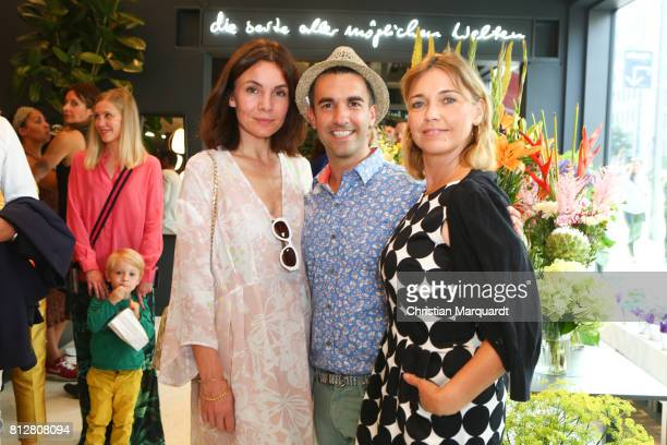 Nadine Warmuth Kian ShamsDolatabad and TIna Ruland attend the 'Kians Garden Flower Shop' Opening Event at Kantstrasse on July 11 2017 in Berlin...