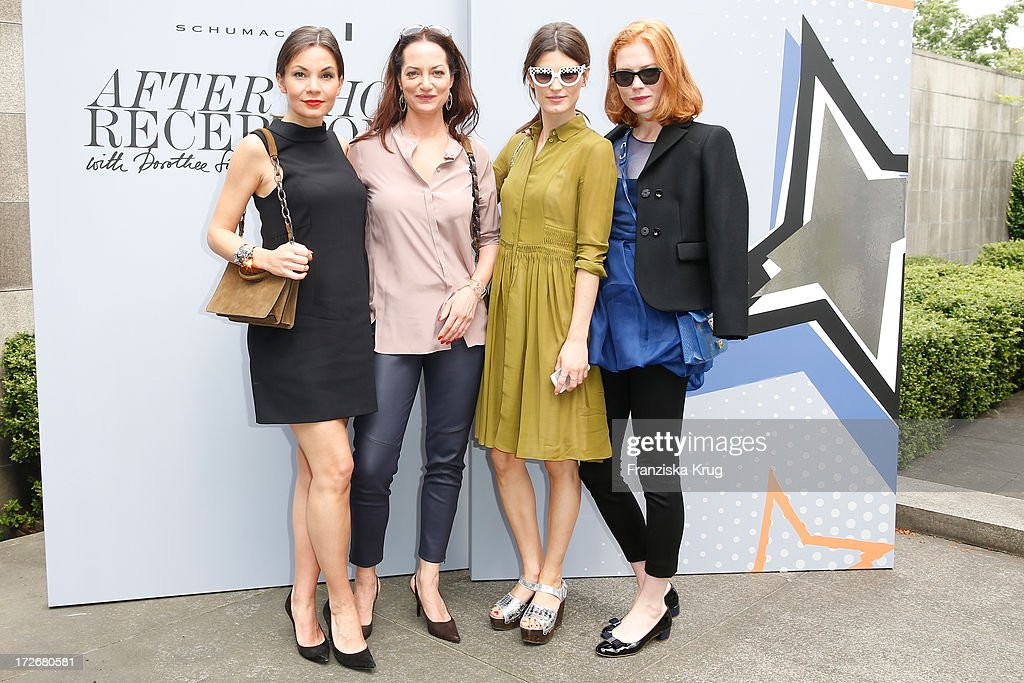 Nadine Warmuth, Natalia Woerner, Hanneli Mustaparta and Jessica Joffe pose at the Schumacher After Show Party at Brandenburg Gate on July 4, 2013 in Berlin, Germany.