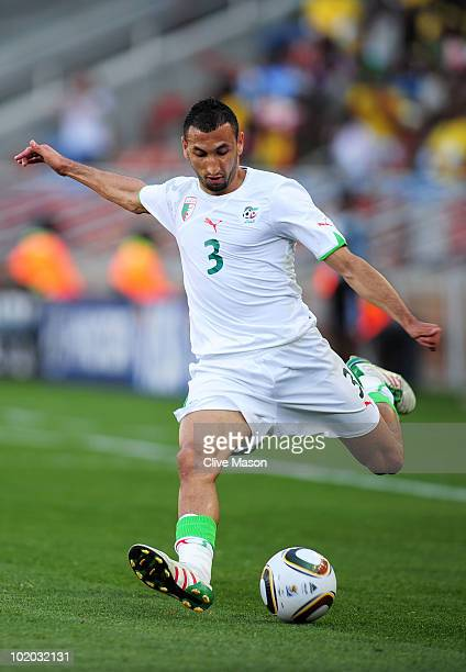 Nadir Belhadj of Algeria crosses the ball during the 2010 FIFA World Cup South Africa Group C match between Algeria and Slovenia at the Peter Mokaba...