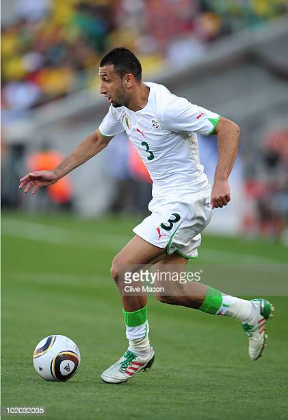 Nadir Belhadj of Algeria runs with the ball during the 2010 FIFA World Cup South Africa Group C match between Algeria and Slovenia at the Peter...