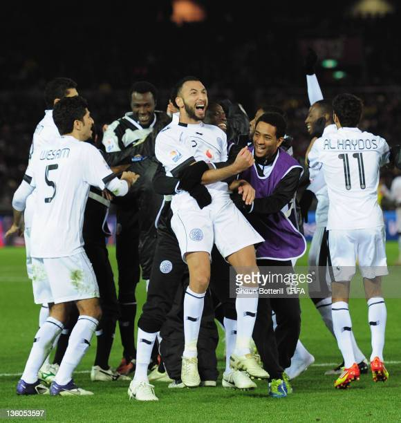 Nadir Belhadj of AlSadd is congratulated after scoring the winning penalty after the FIFA Club World Cup 3rd place match between Kashiwa Reysol and...