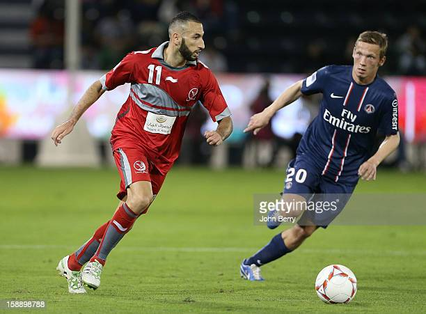 Nadir Belhadj of Lekhwiya SC and Clement Chantome of PSG in action during the friendly match between Paris SaintGermain FC and Lekhwiya Sports Club...