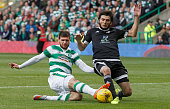 Nadir Ciftci of Celtic and Bedavi Huseynov of FK Qarabag in action during the UEFA Champions League Third Qualifying Round 1st Leg match between...