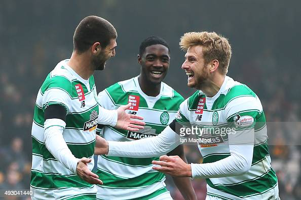 Nadir Ciftci of Celtic celebrates scoring with Stuart Armstrong of Celtic during the Ladbrokes Scottish Premiership match between Motherwell and...