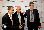 Nadir Mohamed president and chief executive officer of Rogers Communications Inc left and Thorsten Heins president and chief executive officer of...
