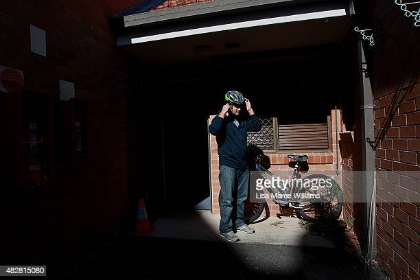 Nadir Sadiqi prepares for a bike ride at his temporary apartment on August 3 2015 in Brisbane Australia Nadir Sadiqi father of three young children...