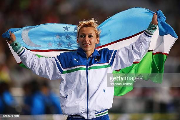 Nadiya Dusanova of Uzbekistan celebrates claiming the Bronze medal following the Women's High Jump Final during day thirteen of the 2014 Asian Games...