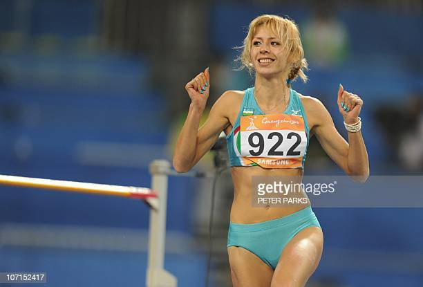 Nadiya Dusanova of Uzbekistan reacts after a jump in the women's high jump final in the athletics competition at the 16th Asian Games in Guangzhou on...