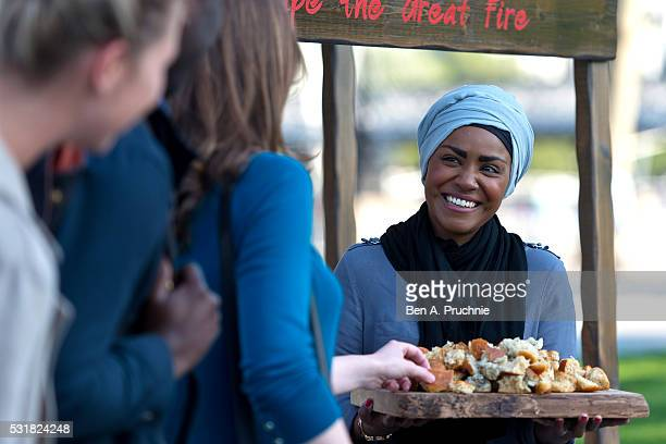 Nadiya Hussain poses with a Great Fire of London inspired bake during a photocall opening a new experience at The London Dungeon which marks the...