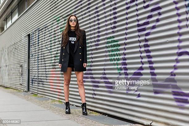 Nadja Ali wearing a black HM x Balmain blazer with golden buttons a black Givenchy shirt black Levis shorts black Zara boots Dior sunglasses on April...