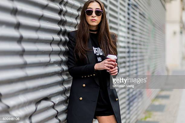 Nadja Ali wearing a black HM x Balmain blazer with golden buttons a black Givenchy shirt black Levis shorts Dior sunglasses on April 11 2016 in...