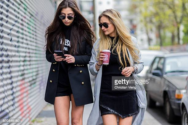 Nadja Ali wearing a black HM x Balmain blazer with golden buttons a black Givenchy shirt black Levis shorts Dior sunglasses and Olivia Faeh wearing a...