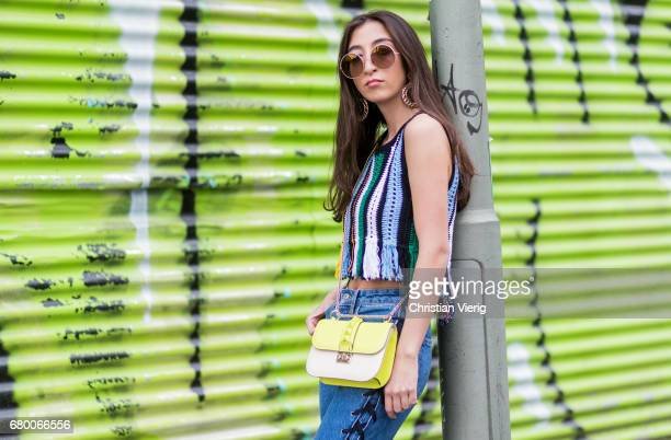 Nadja Ali wearing a Lala Berlin Top blue HM denim Jeans black Balenciaga Boots a neon yellow green Valentino Bag Marc Jacobs sunglasses vintage...