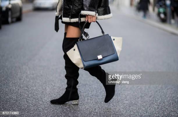 Nadja Ali wearing a Monki sherling jacket white HM knit black mini skirt Zara black overknees Mint Berry Celine bag Chanel necklace on November 4...