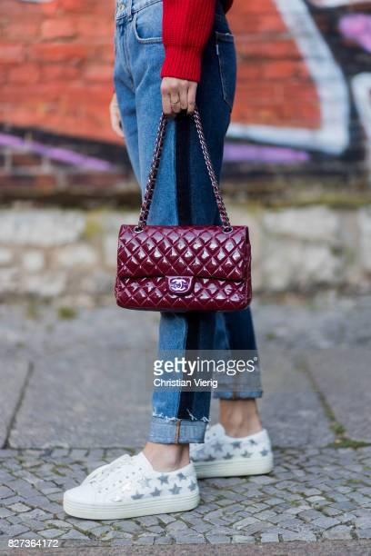 Nadja Ali wearing a red Dondup sweater MSGM two tone denim jeans red Chanel bag Zero vintage sunglasses Saint Laurent sneakers Chanel necklace on...
