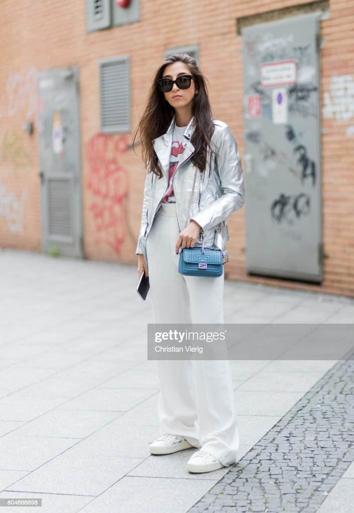 Nadja Ali wearing a silver leather jacket Be Edgy, a tshirt with a tongue print Brandy Mellville,, white Zara pants, Saint Laurent sneakers, blue Fendi bag, Celine sunglasses on June 30, 2017 in Berlin, Germany.