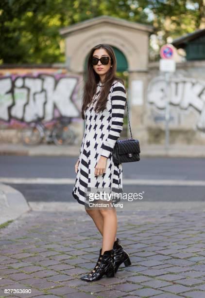 Nadja Ali wearing a white black MSGM dress black Lala Berlin boots black Chanel bag Celine sunglasses Chanel necklace on August 7 2017 in Berlin...