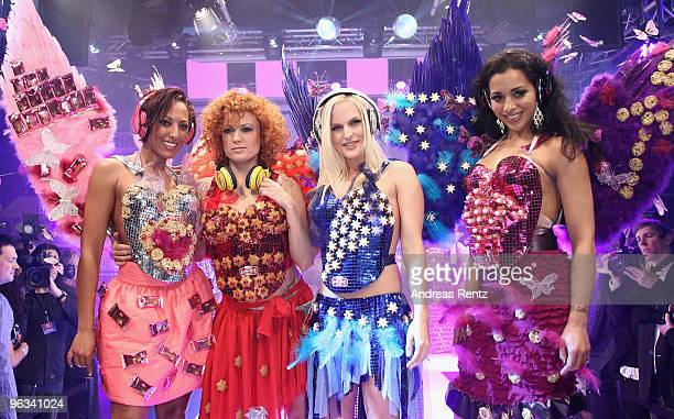 Nadja Benaissa Lucy Diakovska Sandy Moelling and Jessica Wahls of the pop group No Angels run down the runway during the Lambertz Monday Night Schoko...