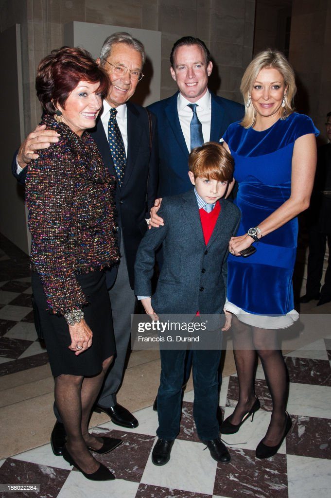 <a gi-track='captionPersonalityLinkClicked' href=/galleries/search?phrase=Nadja+Swarovski&family=editorial&specificpeople=653118 ng-click='$event.stopPropagation()'>Nadja Swarovski</a> poses with her husband Rupert Adams, her son Rigby and her mother attend the Swarovski Dinner In Honor of the Bouroullec Brothers at Chateau de Versailles on November 14, 2013 in Versailles, France.