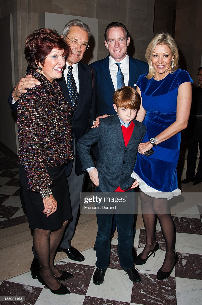 Nadja Swarovski poses with her husband Rupert Adams, her son Rigby and her mother attend the Swarovski Dinner In Honor of the Bouroullec Brothers at Chateau de Versailles on November 14, 2013 in Versailles, France.