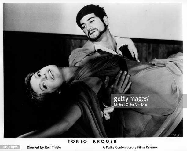 Nadja Tiller falls into the arms of JeanClaude Brialy as Tonio Kroeger in a scene from the movie 'Tonio Kroeger' circa 1964