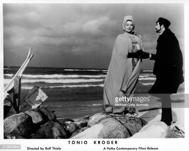 Nadja Tiller walks with JeanClaude Brialy as Tonio Kroeger in a scene from the movie 'Tonio Kroeger' circa 1964