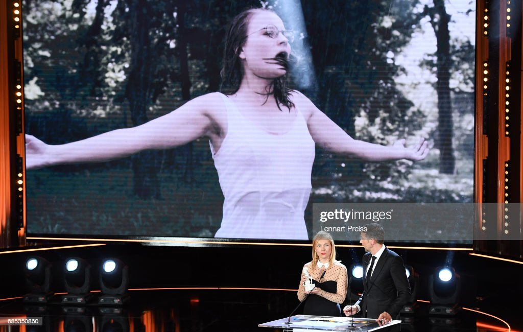Nadja Uhl and Kai Wiesinger present the award for Sonja Gerhardt, winner of the category 'Best Female Actor' during the Bayerischer Fernsehpreis 2017 show at Prinzregententheater on May 19, 2017 in Munich, Germany.