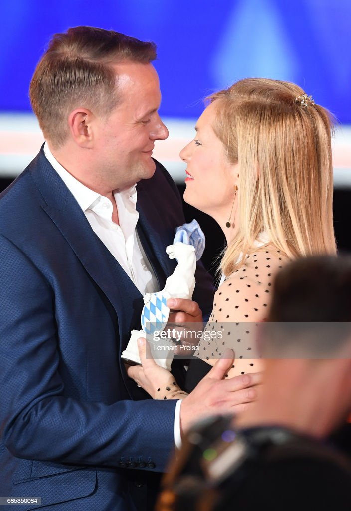 Nadja Uhl hands over the award to Devid Striesow, winner of the category 'Best Male Actor', during the Bayerischer Fernsehpreis 2017 show at Prinzregententheater on May 19, 2017 in Munich, Germany.