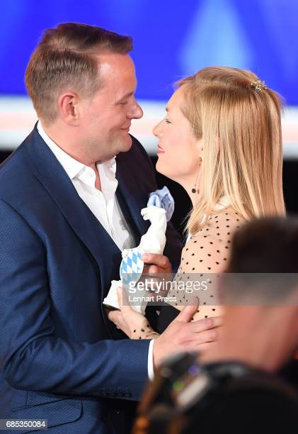 Nadja Uhl hands over the award to Devid Striesow winner of the category 'Best Male Actor' during the Bayerischer Fernsehpreis 2017 show at...