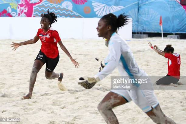 Nae Harris of Trinidad Tobago celebrates victory in the girl's beach soccer gold medal final match between Trinidad Tobago and Jamaica on day 5 of...