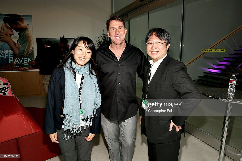 Naeko Yoda of GAGA Corporation, Japan, author Nicholas Sparks andTakao Mizuno of GAGA Corporation, Japan attend the 'Safe Haven' AFM Reception at RealD Screening Room on November 2, 2012 in Beverly Hills, California.