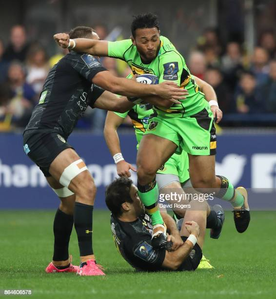 Nafi Tuitavake of Northampton is tackled by Morgan Parra and Alexandre Lapandry during the European Rugby Champions Cup match between ASM Clermont...