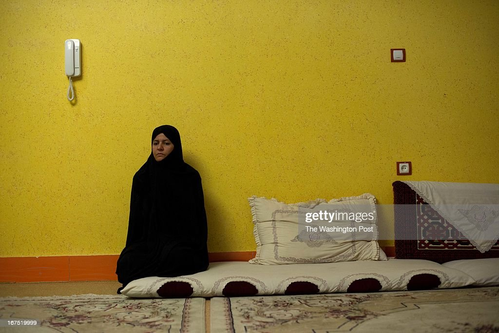 Nafisa Nabizada sit in mourning at her home on April 9, 2013 in Herat, Afghanistan. Her family paid $65,000 ransom to kidnappers for her 9 yr-old son, Ali Sena Nowruzee, only to find that the boy was murdered by the men who took him , including a family bodyguard. Herat's relative success economically have caused hundreds of kidnappings, with families of businessmen paying large sums to ransom their relatives.