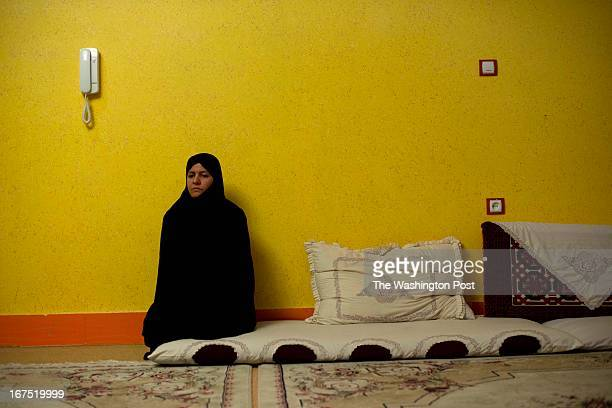 Nafisa Nabizada sit in mourning at her home on April 9 2013 in Herat Afghanistan Her family paid $65000 ransom to kidnappers for her 9 yrold son Ali...
