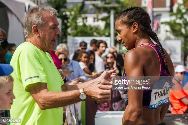 Nafissatou Thiam of Belgium receives instructions from her coach Roger Lespagnard during the women Long Jump during the Urban Memorial Van Damme on...