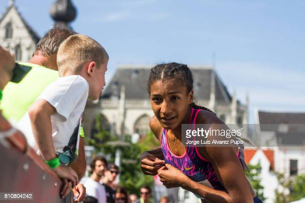 Nafissatou Thiam of Belgium talks to a kid during the women Long Jump during the Urban Memorial Van Damme on July 08 2017 at the Grand Plaza in...