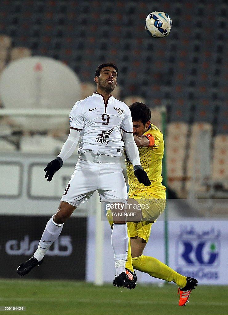 Naft Tehran's Alireza Ezzat (R) and Qatar's El Jaish Abderrazzaq Hamdallah (L) jump to head the ball during their AFC Champions League 3rd qualifying round play-off football match at the Azadi stadium in Tehran on February 9, 2016. / AFP / ATTA KENARE