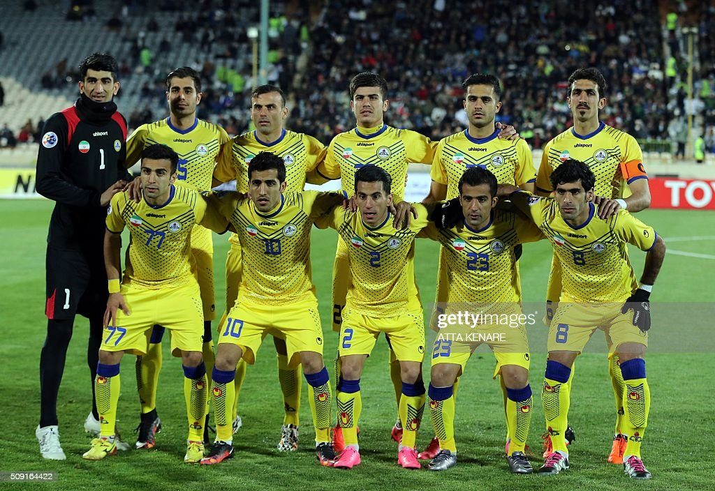 Naft Tehran's first eleven pose for a group picture before their AFC Champions League 3rd qualifying round play-off football match at the Azadi stadium in Tehran on February 9, 2016. / AFP / ATTA KENARE