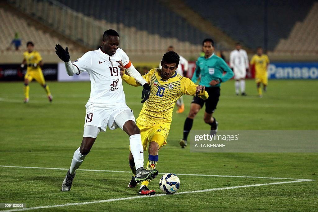 Naft Tehran's Vahi Amiri (R) fights for the ball with Qatar's El Jaish player Mohammad Abdulrahman (R) during their AFC Champions League 3rd qualifying round play-off football match at the Azadi stadium in Tehran on February 9, 2016. / AFP / ATTA KENARE