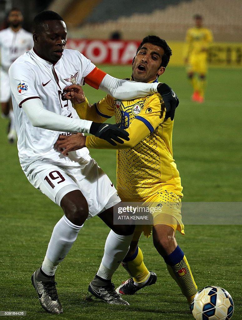 Naft Tehran's Vahi Amiri (R) fights for the ball with Qatar's El Jaish player Mohammad Abdulrahman (R) during their AFC Champions League 3rd qualifying round play-off football match at the Azadi stadium in Tehran on February 9, 2016. / AFP / ATTA KENARE